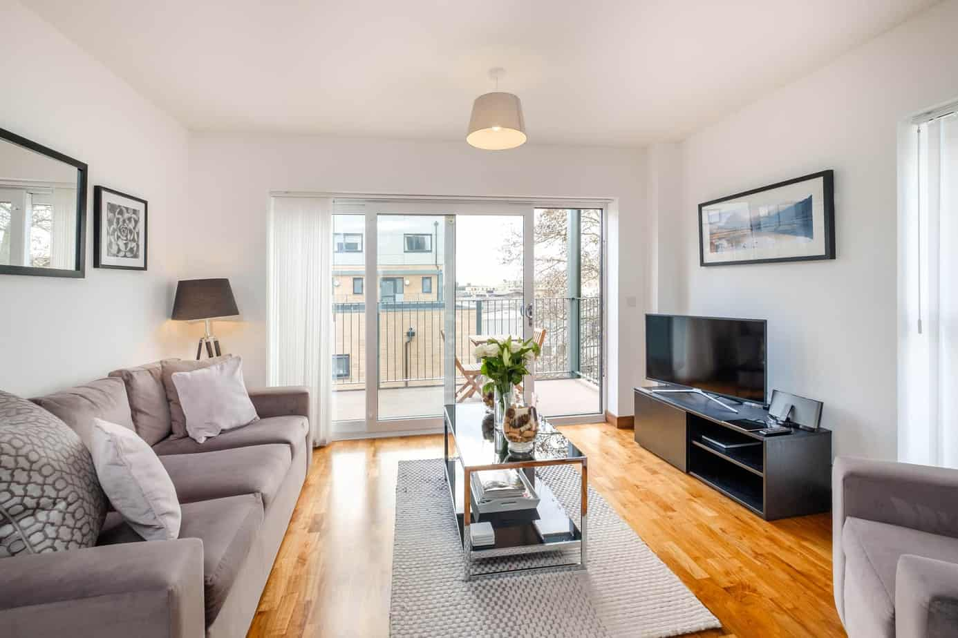 Grand Central Serviced Apartment Cambridge Tailored Stays livingroom with grey sofa
