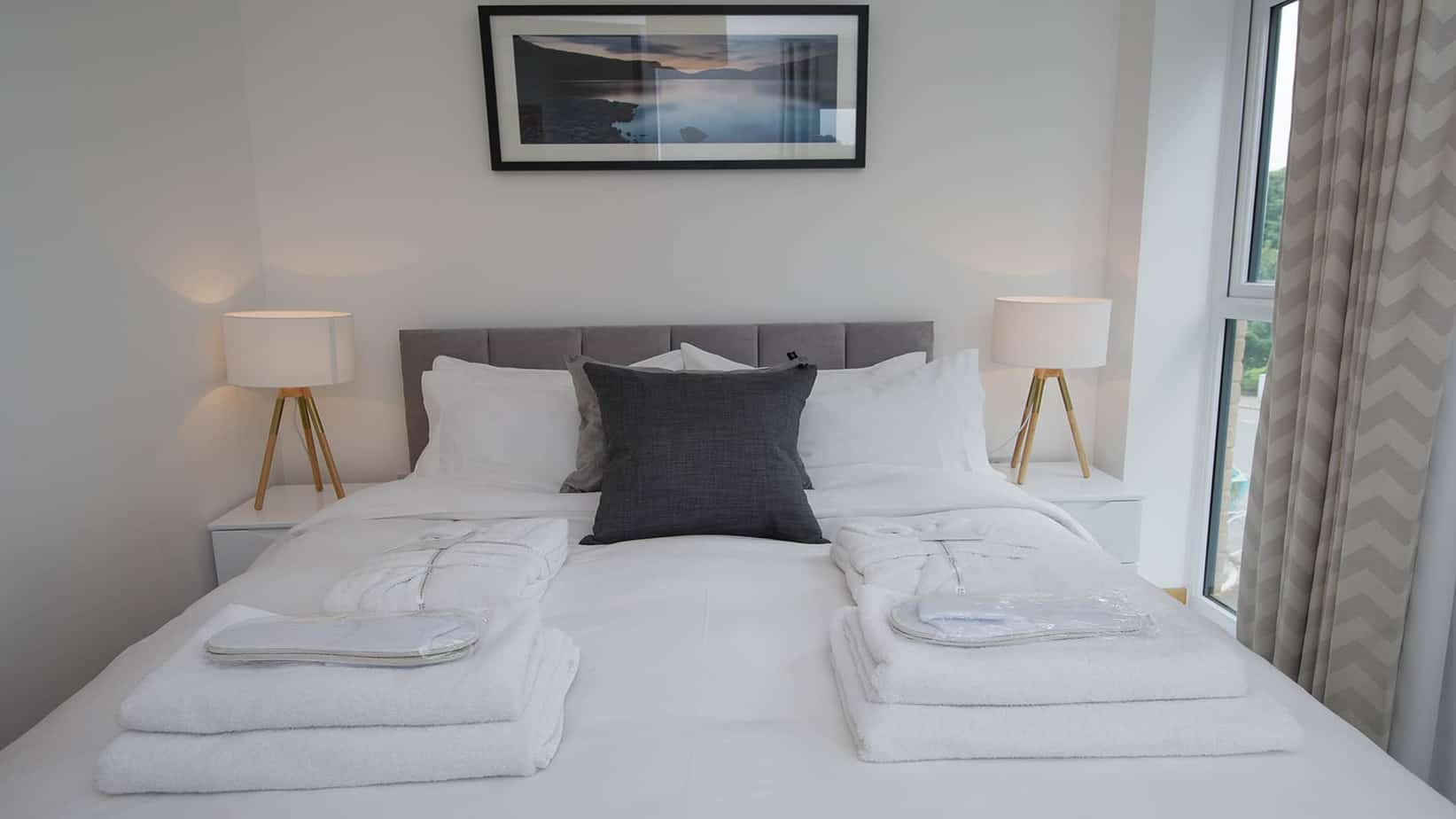 Tailored Stays Executive Townhouse master bedroom with egyptian cotton bedding and duck down duvets